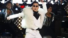 Psy performs his hit Gangnam Style in Times Square during New Year's Eve celebrations in New York. (Charles Sykes/AP)