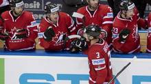 Canada's captain Kevin Bieksa is congratulated by teammates Nazem Kadri, from the left, Matt Read, Troy Brouwer and Sean Monahan after he scored the third goal against Slovakia during third period action at the IIHF Ice Hockey World Championship in Minsk, Belarus, on May 10. (Jacques Boissinot/THE CANADIAN PRESS)