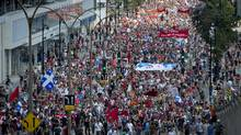 Thousands of people take to the streets of Montreal in a mass demonstration against the Quebec Liberal governments policies, including university fee hikes and Bill 78 on Sunday, July 22, 2012. (Peter McCabe/CP Photo)