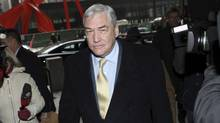 Conrad Black arrives at the Federal Courthouse in Chicago for a status hearing, January 13, 2011. Black and fellow executives at Hollinger International Inc were convicted in July 2007 of defrauding the Chicago-based newspaper publisher when they paid themselves non-compete fees as they sold off parts of the company. Black was freed on bail in July 2010 after spending nearly 2-1/2 years of his 6-1/2-year sentence in a Florida prison, pending the outcome of his appeal. (JOHN GRESS/John Gress/Reuters)