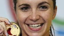 Canada's Audrey LaCroix poses with her gold medal in the women's 200m Butterfly at the 2014 Commonwealth Games in Glasgow, Scotland, July 28, 2014. (Reuters)