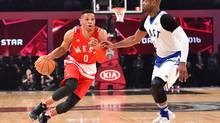Western Conference guard Russell Westbrook of the Oklahoma City Thunder (0) drives against Eastern Conference guard Dwyane Wade of the Miami Heat (3) in the first half of the NBA All Star Game at Air Canada Centre. (Bob Donnan/USA Today Sports)