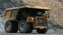 A Caterpillar 793 mining truck hauls gold bearing ore. (STEPHEN HILGER/BLOOMBERG NEWS)