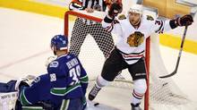 Chicago Blackhawks' Kris Versteeg celebrates after scoring the first goal against Vancouver Canucks goaltender Roberto Luongo as Canucks' Pavol Demitra looks on during first period of game 3 NHL western conference playoff hockey action at GM Place in Vancouver, Wednesday, May 5, 2010 (Jonathan Hayward/THE CANADIAN PRESS)
