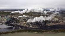 Oil and gas production, such as the work done at this Suncor processing plant in For McMurray, Alta., was the country's fastest-growing source of emissions between 2005 and 2013. (Todd Korol/Reuters)
