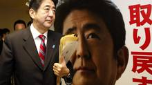 Shinzo Abe, Japan's incoming prime minister and the leader of Liberal Democratic Party (LDP), walks past his portrait after attending a meeting at the LDP headquarters in Tokyo on Dec. 21, 2012. (Toru Hanai/REUTERS)