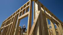 A contractor works on a new home under construction in Dublin, Calif. (David Paul Morris/Bloomberg)