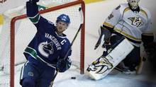 Vancouver Canucks' Henrik Sedin celebrates his penalty shot goal against Nashville Predators goalie Chris Mason during the third period of their NHL game in Vancouver, British Columbia March 14, 2013. (ANDY CLARK/REUTERS)