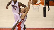 Toronto Raptors centre Jonas Valanciunas dunks against the Memphis Grizzlies at Air Canada Centre in Toronto on March 14, 2014. (Tom Szczerbowski/USA Today Sports)