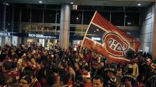 Montreal Canadien fans celebrate following their win over the Boston Bruins to push the series to a best of 7, in Montreal, May 12, 2014. (Christinne Muschi/Christinne Muschi/The Globe and)
