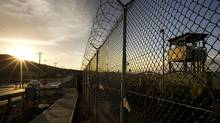 The sun rises over the Camp Delta detention compound, which has housed foreign prisoners since 2002, at the U.S. naval base at Guantanamo Bay, Cuba. (BRENNAN LINSLEY/BRENNAN LINSLEY/AFP/Getty Images)