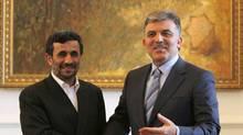 Turkish President Abdullah Gul (R) shakes hands with Iranian President Mahmoud Ahmadinejad during their meeting in Istanbul June 7, 2010. (MURAD SEZER/REUTERS)