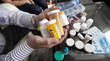 Cystic Fibrosis sufferer Erick Bauer, 28 holds some of the medications he must take at his home in Toronto on May 09, 2013. A new drug that has recently been approved to treat the disease. The drug is called Kalydeco and it's the first drug to ever treat the cause of cystic fibrosis, rather than the symptoms. It's not a cure, and although Bauer will not be able to take this drug, it represents a huge step forward in helping patients manage the disease. The problem is the drug costs about $300,000 a year in Canada. (Deborah Baic/The Globe and Mail)