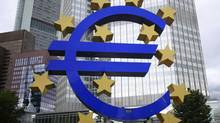 A structure showing the Euro currency sign is seen in front of the European Central Bank (ECB) headquarters in Frankfurt. (ALEX DOMANSKI/REUTERS)