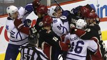 Toronto Maple Leafs players (in white) and Phoenix Coyotes players fight during the second period of their NHL hockey game in Glendale, Arizona, January 13, 2011. (JOSHUA LOTT)