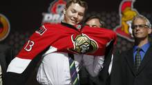 Curtis Lazar tries on an Ottawa Senators jersey after being selected by the Senators as the 17th overall pick in the 2013 National Hockey league (NHL) draft in Newark, New Jersey, June 30, 2013. (BRENDAN MCDERMID/REUTERS)