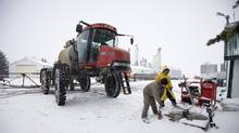 Workers prepare to pressure wash a sprayer at the Wigmore Farms near Regina on Wednesday, Nov. 10, 2010. (TROY FLEECE/Troy Fleece for the Globe and Mail)