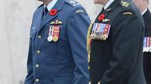 Incoming Chief of Defence Staff Lieutenant-General Tom Lawson, left, and outgoing Chief of Defence Staff General Walter Natynczyk are seen at the Change of Command ceremony in Ottawa, Oct. 29, 2012. (Adrian Wyld/THE CANADIAN PRESS)
