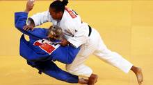 France's Lucie Decosse, right, fights with Canada's Kelita Zupancic during their women's -70kg judo match at the London 2012 Olympic Games on Wednesday (DARREN STAPLES/REUTERS)