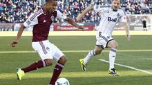 Vancouver Whitecaps defender Jordan Harvey (2) watches as Colorado Rapids forward Gabriel Torres (30) takes a shot in the first half at Dick's Sporting Goods Park. (Isaiah Downing/USA Today Sports)