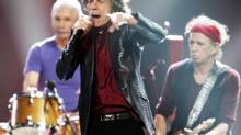 "Mick Jagger, Keith Richards (R) and Charlie Watts (L) of the Rolling Stones perform during the ""12-12-12"" benefit concert for victims of Superstorm Sandy at Madison Square Garden in New York December 12, 2012. (LUCAS JACKSON/REUTERS)"