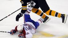 Canadiens center David Desharnais goes for a slide during the third period in Game 5 of their NHL Eastern Conference quarter-final hockey game in Boston on April 23. (BRIAN SNYDER/REUTERS)