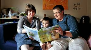 TORONTO: July 29, 2010 -- Melanie Chamberland (left) and her wife Ruthanne Price read to their three-year-old son Ezra Chamberland Price.