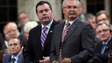 Immigration Minister Jason Kenney, left, and Agriculture Minister Gerry Ritz vote on Motion 312 in the House of Commons on Wednesday Sept. 26, 2012. (FRED CHARTRAND/THE CANADIAN PRESS)