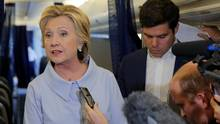 U.S. Democratic presidential candidate Hillary Clinton answers questions from reporters on her campaign plane enroute to a campaign stop in Moline, Illinois, United States September 5, 2016. (BRIAN SNYDER/REUTERS)