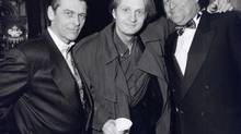 Bill Ballard, right, with singer Tom Cochrane and music publicist James Monaco at the opening of the musical Tommy in Toronto in 1995.