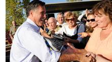 Former Massachusetts governor and Republican presidential hopeful Mitt Romney greets supporters as he opens his Nevada campaign headquarters Oct.17, 2011 in Las Vegas. (Ethan Miller/Getty Images)