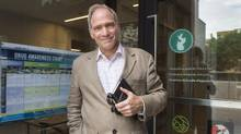 Louis Letellier de St-Just, chairman of CACTUS, a local community health organization, stands in front of one of Montreal's new supervised injection sites on Monday, June 19, 2017. (Ryan Remiorz/THE CANADIAN PRESS)
