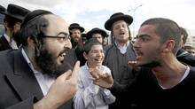 An ultra-Orthodox man argues with a secular counterpart during a protest about religious zealotry in Beit Shemesh, Israel. (Reuters)