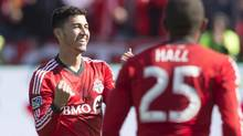 Toronto FC 's Jonathan Osorio (left) celebrates scoring his team's second goal against L.A. Galaxy in front of Jeremy Hall during second half MLS action in Toronto on Saturday, March 30, 2013. Osorio has earned his first call-up to the Canadian national team.The 20-year-old from Toronto is one of 18 players summoned by interim coach Colin Miller for a May 28 friendly against Costa Rica at Edmonton's Commonwealth Stadium.THE CANADIAN PRESS/Chris Young (Chris Young/THE CANADIAN PRESS)