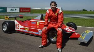 Jacques Villeneuve poses with his father's car.