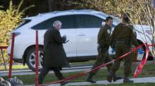 Police investigators examine the crime scene where alleged mob boss Joseph Di Maulo was murdered in front of his home Nov. 5, 2012 in Blainville, Que. north of Montreal. (Ryan Remiorz/THE CANADIAN PRESS)
