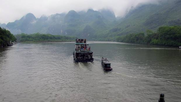 A search for iconic China often takes tourists to the Great Wall and the Terracotta Warriors. But for a glimpse of natural beauty board a boat for a four-hour cruise down the Li River from Guilin to the picturesque city of Yangshuo. (PAT EATON-ROBB/AP)