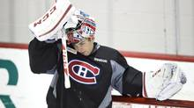 Montreal Canadiens goaltender Carey Price slips on his face mask during their training camp Tuesday, January 15, 2013 in Brossard, Que. (Paul Chiasson/THE CANADIAN PRESS)