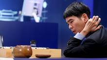 The world's top Go player Lee Sedol reviews the match after the fourth match against Google's artificial intelligence program AlphaGo in Seoul on March 13, 2016. (HANDOUT/REUTERS)