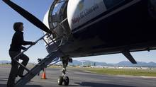 BC Liberal leader Christy Clark boards her campaign plane in Vancouver May 6, 2013. (John Lehmann/The Globe and Mail)