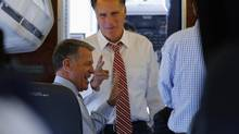 Republican presidential nominee Mitt Romney talks to senior advisor Bob White on his campaign plane at the airport in Denver, Colorado Thursday Oct 4, 2012. (BRIAN SNYDER/REUTERS)
