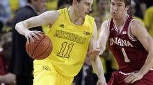 Michigan's guard Nik Stauskas of Mississauga, Ont. drives against Indiana's guard Jordan Hulls during the first half of their NCAA college basketball game in Ann Arbor, Michigan March 10, 2013. (REBECCA COOK/REUTERS)