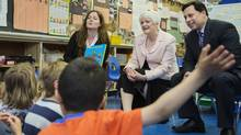 Ontario Minister of Education Liz Sandals (centre) and Minister of Training, Colleges and Universities Brad Duguid (right) visit a full-day kindergarten class in Toronto before announcing that the government will be doubling the time students spend in teacher's college and reducing teacher's college admissions in the province by 50 percent. (Della Rollins for the Globe and Mail)