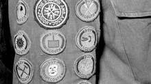 JANUARY 1953 -- BOY SCOUT BADGES -- Every Scout works towards earning proficiency badges, mark of achievement in many fields, as part of Canada-wide program. (Alex Gray/Alex Gray)