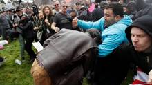 """A demonstrator in support of U.S. President Donald Trump scuffles with a counter-protester during a """"People 4 Trump"""" rally in Berkeley, Calif., March 4, 2017. (STEPHEN LAM/REUTERS)"""