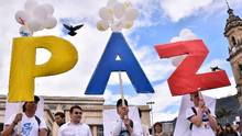 People gather in Bogota's Bolivar Square on Sept. 26, 2016, to celebrate the agreement to end a half-century of war in Colombia. (GUILLERMO LEGARIA/AFP/Getty Images)