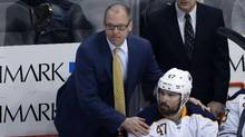 Buffalo Sabres head coach Dan Bylsma stands behind Zach Bogosian (47) during the third period of an NHL hockey game against the Pittsburgh Penguins in Pittsburgh, Sunday, March 5, 2017. (Gene J. Puskar/THE ASSOCIATED PRESS)