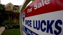 A for sale sign sits on the lawn of a Vancouver home. (DARRYL DYCK For The Globe and Mail)