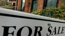 "A ""For Sale"" sign is posted outside of at Toronto townhome. (Tim Fraser/Tim Fraser/For The Globe and Mail)"
