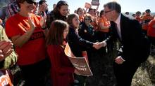 B.C. NDP Leader Adrian Dix greets supporters during a campaign stop along the North Thompson River in Kamloops, B.C., on April 22, 2013. (Darryl Dyck/The Canadian Press)